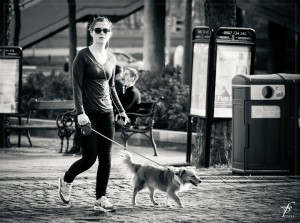 Walking the dog with headphones and a phone in one hand. (Photo: Ferobanjo on Pixabay CC-0)