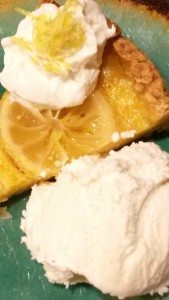 slice of pie with whipped cream and ice cream