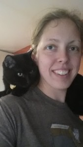 cat sitting on person's shoulders