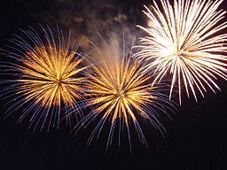 three fireworks in a dark sky