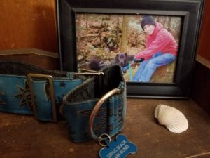 Dog collar, shell, and framed photo of man and dog